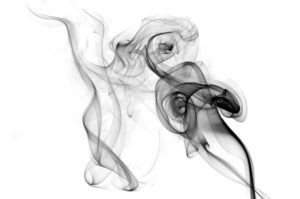 Black smoke on white background in shape of dancing figure